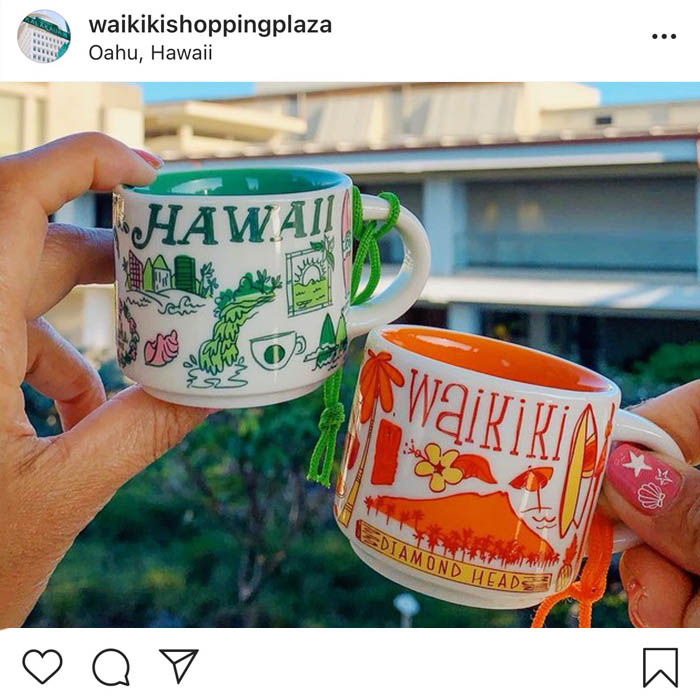 Two mugs decorated with the print Hawaii and Waikiki