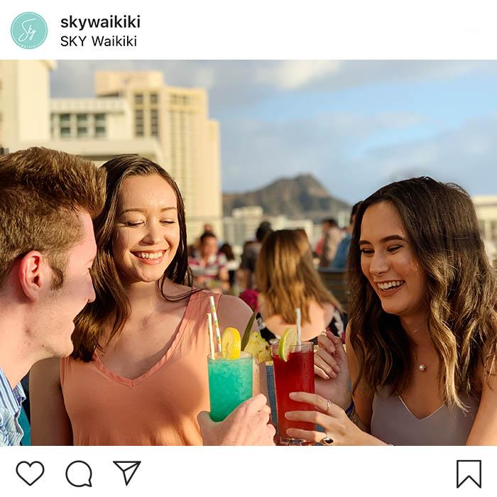 Friends celebrating Happy Hour in Waikiki